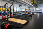 A large weight room in an indoor fitness facility