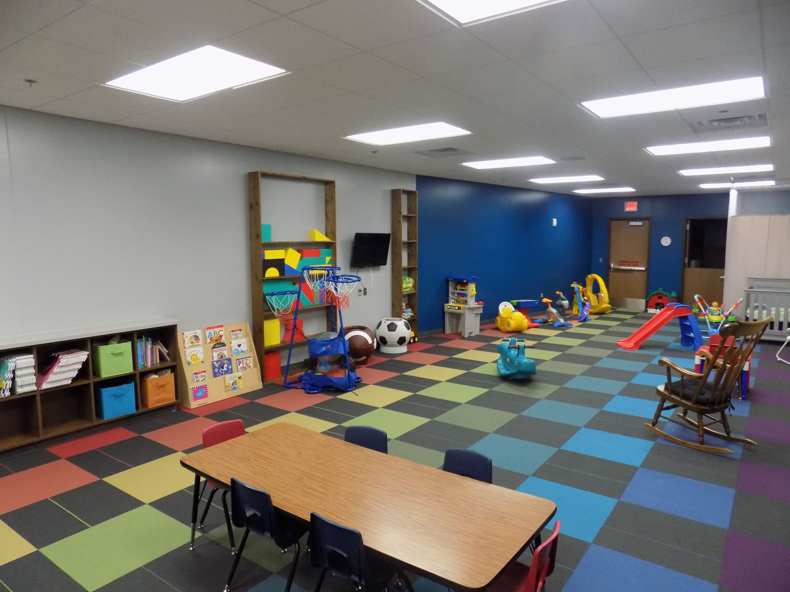 A children's playroom full of toys